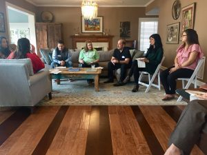 Group gathered in living room for discussion.